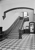 Entrance hall main stair with wood banister