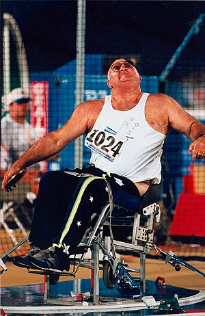 Terry Giddy - Giddy competing in the F55 seated discus throw event at the 1996 Atlanta Paralympics