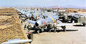 Suwon Air Base - United States Air Force North American F-86 Sabre fighters from the 51st Fighter Interceptor Wing Checkertails are readied for combat during the Korean War at Suwon Air Base