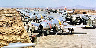 North American F-86 Sabre - United States Air Force North American F-86 Sabre fighters from the 51st Fighter Interceptor Wing Checkertails are readied for combat during the Korean War at Suwon Air Base