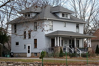 American Foursquare - A wood-frame American Foursquare house in Minnesota with dormer windows on each side and a large front porch