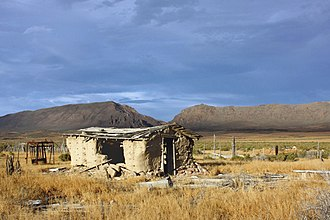 Lander County, Nevada - Derelict building off State Route 305 in the Reese River Valley with the Shoshone Range in the distance