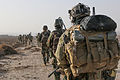 A U.S. Army Special Forces Soldier with Combined Joint Special Operations Task Force-Afghanistan and Afghan National Army commandos with the 3rd Company, 3rd Special Operations Kandak move toward a compound 140101-A-LW390-143.jpg