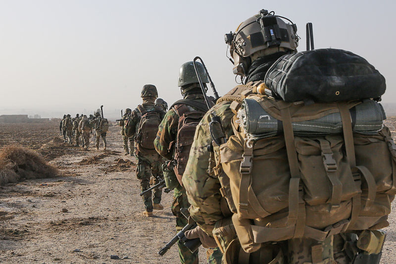 File:A U.S. Army Special Forces Soldier with Combined Joint Special Operations Task Force-Afghanistan and Afghan National Army commandos with the 3rd Company, 3rd Special Operations Kandak move toward a compound 140101-A-LW390-143.jpg