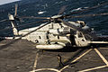 A U.S. Marine Corps CH-53E Super Stallion helicopter assigned to Marine Medium Tiltrotor Squadron (VMM) 266 prepares to take off from the flight deck of the amphibious transport dock ship USS San Antonio (LPD 131104-M-HF949-003.jpg