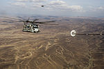 A U.S. Marine Corps CH-53E Super Stallion helicopter prepares to receive fuel from an Air Force HC-130J Combat King II aircraft during aerial refueling operations in support of the Combined Joint Task Force-Horn 131115-F-VY794-590.jpg