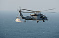 A U.S. Navy MH-60S Seahawk helicopter assigned to Helicopter Sea Combat Squadron (HSC) 26 approaches the guided missile destroyer USS Hopper (DDG 70) during exercise Spartan Kopis Dec. 8, 2013, in the Persian 131208-N-OU681-390.jpg