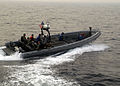 A U.S. Navy rigid-hull inflatable boat transports members of Maritime Civil Affairs and Security Training Command toward the littoral combat ship USS Freedom (LCS 1), not shown, to conduct a visit, board, search 130620-N-UU879-024.jpg