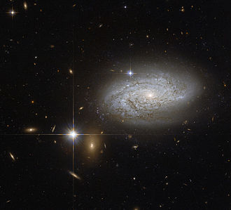 Leo Minor - Spiral galaxy NGC 3021 which lies about 100 million light-years away.