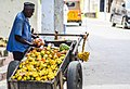 A local fruit Vendor in the old town.jpg