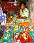 A microfinance client selling her crafts in the market in Nadi, Fiji, 2009. Photo- AusAID (10662515244).jpg