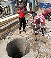 A small boy fetching water in a well.jpg