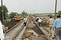 A still of railway track repair work is on progress in the flood-affected areas at Shedhi River, 36 kilometers away from Ahmedabad, Gujarat on July 7, 2005 (1).jpg