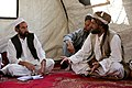 A village elder speaks with provincial government officials during a shura, or meeting, held after a clinic opening ceremony in Mya Neshin district, Kandahar province, Afghanistan, June 1, 2013 130601-A-IS772-209.jpg