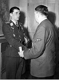 Adolf Hitler hands the award to Walter Nowotny.jpg