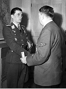 Adolf Hitler hands the award to Walter Nowotny.jpg