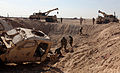 Afghan National Army soldiers with the 3rd Mobile Strike Force attach cables from two MR30 wrecker trucks to a mine-resistant, ambush-protected vehicle with simulated battle damage in a ditch during vehicle 140223-M-JD595-6573.jpg