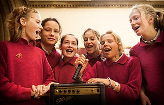 Singing Act of producing musical sounds with the voice