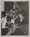 Akseli Gallen-Kallela with workers at Tarvaspää repairing the building, ca.1927; photograph 2. (14705918106).jpg