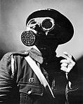 An Air Raid Warden wearing his steel helmet and duty gas mask during the Second World War. D4054.jpg