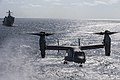 An MV-22B Osprey from Marine Medium Tiltrotor Squadron 262 prepares to land during a simulated VBSS in Philippine Sea in 2019.jpg
