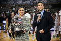 Andy Katz presents trophy ESPN Armed Forces Classic - Game Day - U.S. Army Garrison Humphreys, South Korea - 9 Nov. 2013.jpg