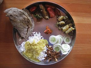 Etiquette of Indian dining - Food serving etiquette without cups, a Thali.