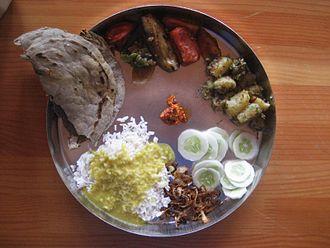 South Indian cuisine - Staple vegetarian meal of Karnataka Jolada rotti, Palya, and anna-saaru.