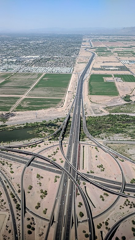 Interchange of 101 (Pima Freeway) with Loop 202 (Red Mountain Freeway) in Mesa (they intersect again further south, in Chandler), with 101 through Scottsdale in the distance Arizona 101 202 interchange in Mesa.jpg