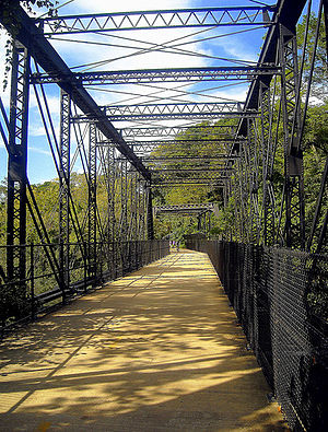 Capital Crescent Trail - The Arizona Avenue Railway Bridge, located in The Palisades neighborhood of Washington, D.C., crosses the C&O Canal and is now part of the Capital Crescent Trail.