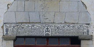 """Atalburu - Iesus Maria Ioseph hilçiaz orhoitg-ziten Io(a)nnes de Urtiaga, Martin d'Errecalde et Maria d'Errecalde, 1727 (the first half translating as """"In memory of JMJ's death"""")"""