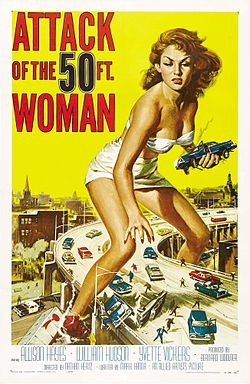 Poster art. A giant woman clad in a white bikini straddles an elevated, 4-lane highway, she has an angry expression, and she's holding one smoking car in her left hand as if it were a toy. She is reaching down to grab another. There are several car crashes on the highway, and people are fleeing from her as if they were small insects.