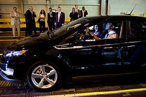 Plug-in hybrid - President Barack Obama behind the wheel of a Chevy Volt plug-in during his tour of the General Motors Auto Plant in Hamtramck, Michigan.