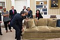 Barack Obama helped to move a sofa back in place in the Oval Office.jpg