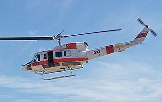 Uruguayan Air Force - A Bell 212 flies over head