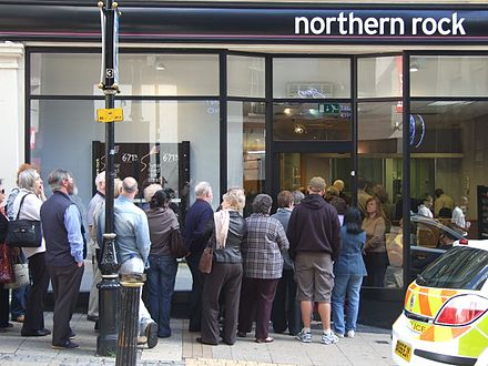 People queuing outside a Northern Rock bank branch in Birmingham, United Kingdom on September 15, 2007, to withdraw their savings because of the Subprime mortgage crisis. Birmingham Northern Rock bank run 2007.jpg