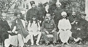 Theosophical Society Adyar - H. P. Blavatsky standing behind Henry Steel Olcott (middle, seated) and Damodar Mavalankar (seated to his left). Bombay, 1881
