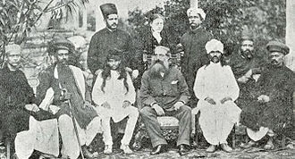 Henry Steel Olcott - Helena Blavatsky standing behind Henry Steele Olcott (middle seated) and Damodar Mavalankar (seated to his left) in Bombay 1881.