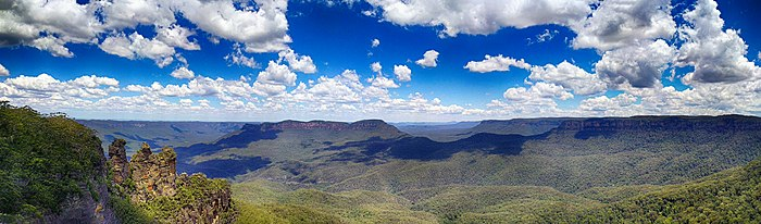 View of Jamison Valley from north escarpment, outside Katoomba: Three Sisters far left; Mount Solitary left of centre; Narrowneck Plateau, far right