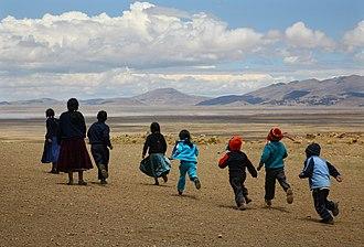 Ancoraimes Municipality - Children play outside school in the community of Maquilaya, Ancoraimes Municipality.