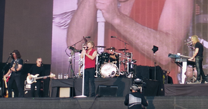 Bon Jovi performing in 2013. From left to right: Phil X, Hugh McDonald, Jon Bon Jovi, Tico Torres, and David Bryan.