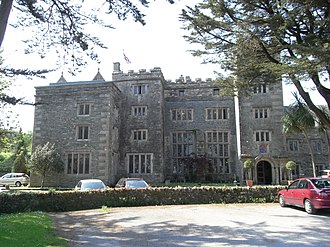 Boringdon Hall - Boringdon Hall, south front, viewed in 2012. The two double-height windows of the Great Hall can be seen to the left of the five storey tower porch