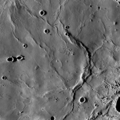 Bow of wrinkle ridges in central Mare Fecunditatis.png