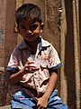 Boy with Drink - Colaba District - Mumbai - Maharashtra - India (25789714473).jpg