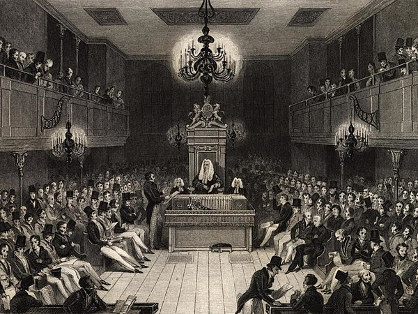 Late in the 17th century Treasury Ministers began to attend the Commons regularly. They were given a reserved place, called the Treasury Bench, to the Speaker's right where the Prime Minister and senior Cabinet members sit today. British House of Commons 1834.jpg