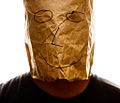 Brown paper bag with happy smiley over head.jpg