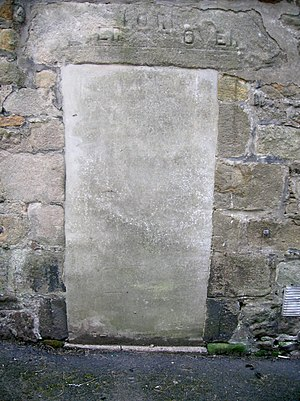 Robert Burnes - The old front door of the Buck's Head Tavern bearing the inscription 'Over Fork Over', Stewarton's motto at one time and that of the Cunninghame family.