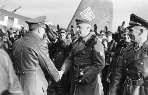 Hans Baur - On 10 March 1943, Hitler flew in to Army Group South's HQ at Zaporozh'ye, Ukraine. Erich von Manstein is greeting Hitler; on the right are Wolfram von Richthofen and Baur.