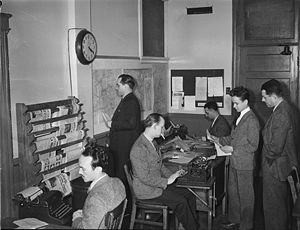 Journalists in the Radio-Canada/CBC newsroom i...