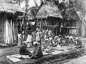 Mandailing people - Plating mats and pounding rice in Pakantan.